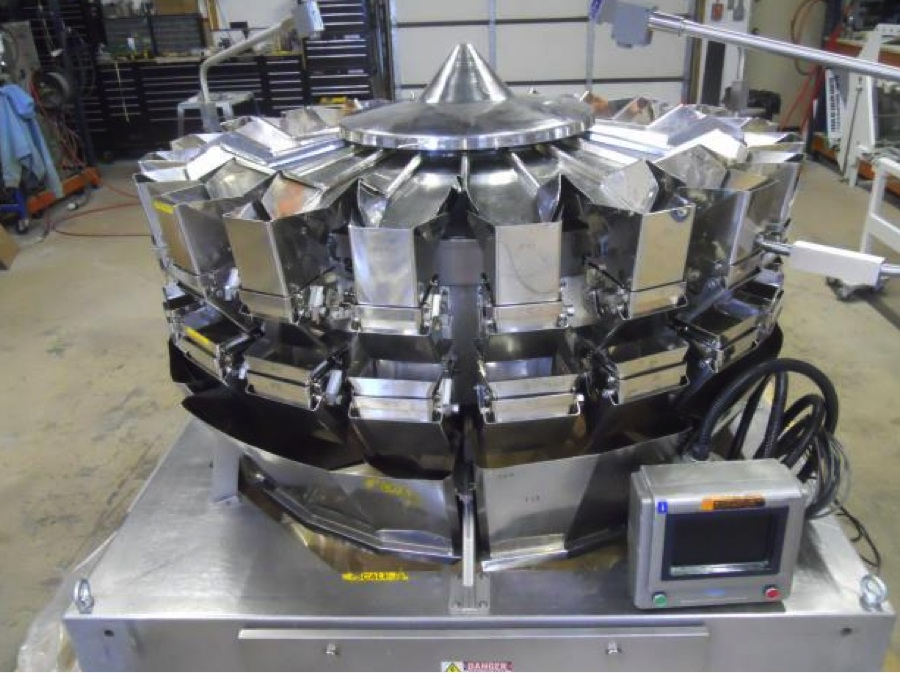 HP Packaging Provides Tech Support for Used Packaging Machines Like This Combination Weigher